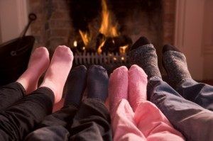 Family Warming Feet by Fireplace