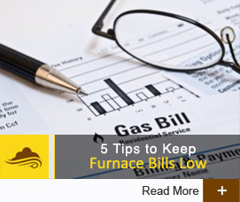 A photograph of a gas bill that says '5 tips to keep furnace bills low'
