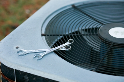 Central Air Conditioner With Wrenches on Top