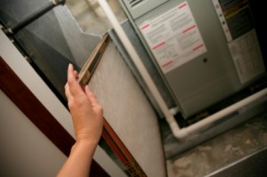Person Changing a Furnace Filter