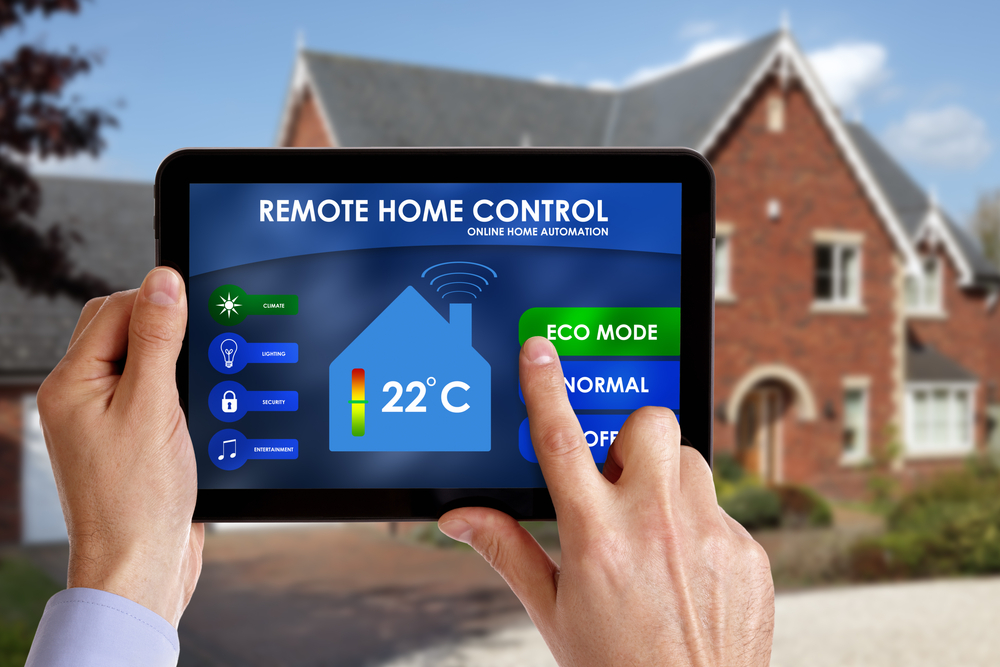 A man using a tablet to remotely control his WiFi thermostat