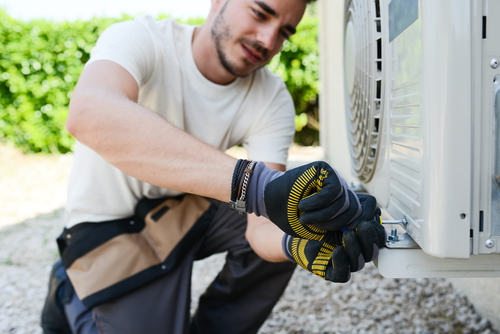 Man Repairing an Air Conditioner