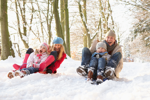 Minnesotan Family Goes Sledding As a Way to Enjoy the Winter Weather and Snow