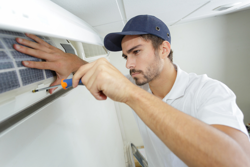Repairman Installing a New Ductless Air Conditioner