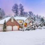 Large Home Covered in Snow