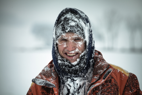 A Man Covered In Snow While Trying to Survive a Minnesota Winter