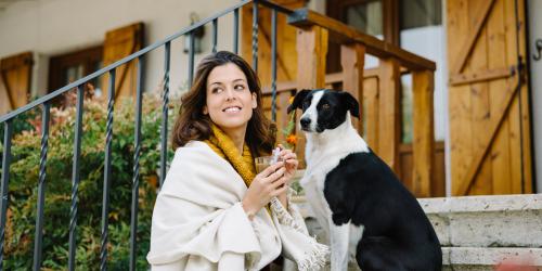 Woman Enjoying Fall Weather While Drinking Coffee