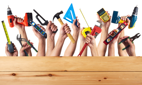 Hands Holding Tools Used For DIY Projects