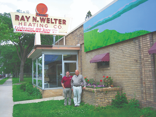 Rick and Ray Welter Stand in Front of Welter Heating