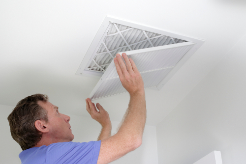 Man Inspecting His Home's Ductwork