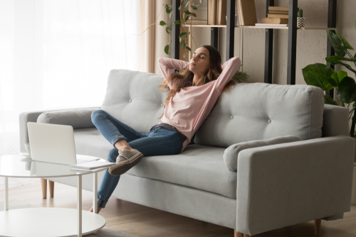 Woman Relaxing in Comfortable Home with Balanced Air